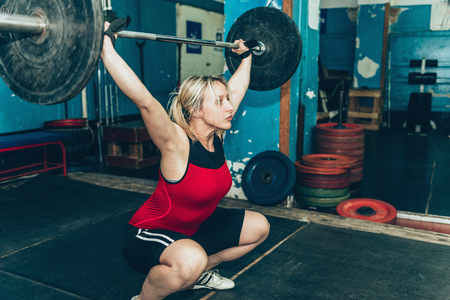 Female on weightlifting training