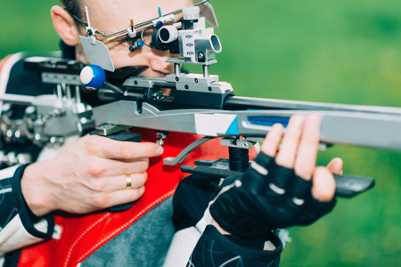 Man practicing for competition sport shooting with free rifle Stock Photo