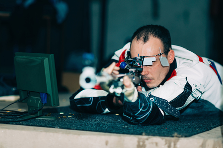 Man on sport shooting training practicing for competition with free rifle 版權商用圖片