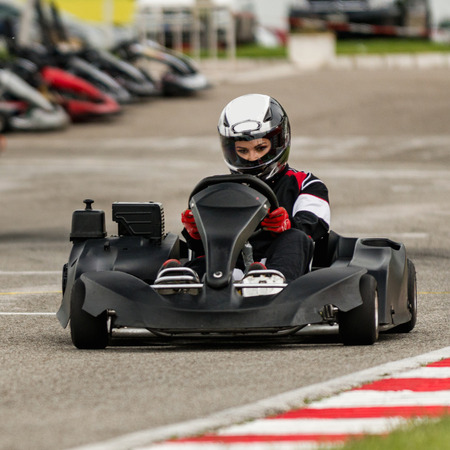 sports track: Woman driving go-cart on a sports track