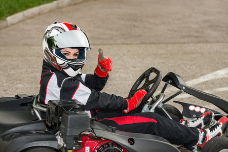 Woman driving go-cart on a sports track