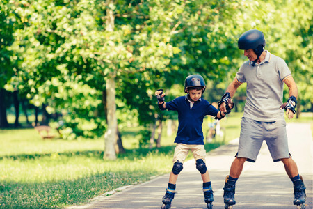 elbow pads: Roller skating, grandfather and grandson in the park