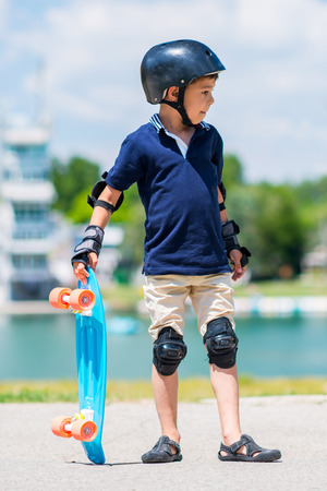 elbow pads: Cool little kid with skateboard