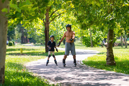 Grandfather and grandson enjoying in the park