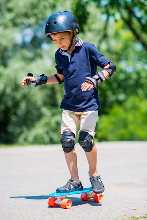 elbow pads: Little boy with skateboard
