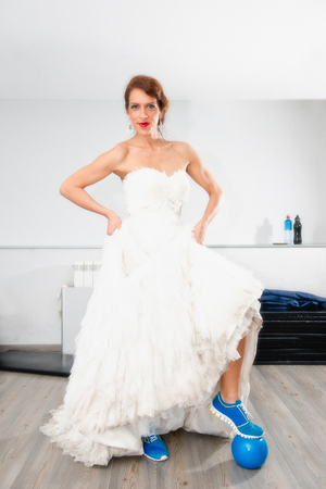 pilates ball: Bride with pilates ball in the gym Stock Photo