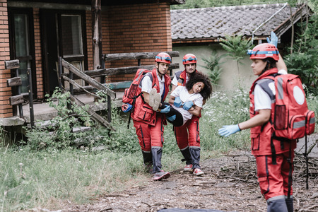 struck: Victim evacuation from disaster struck area Stock Photo