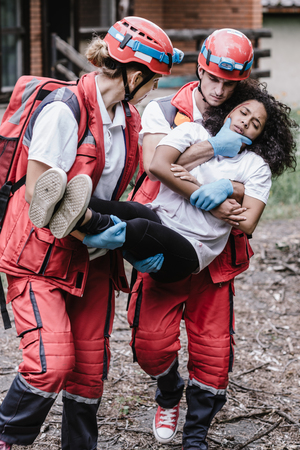 Victim evacuation, rescuers in action Stock Photo