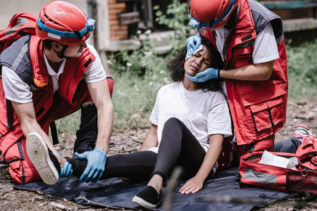 Disaster relief, rescue team helping injured victim Standard-Bild