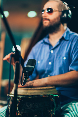 Percussionist playing drums on concert Stock Photo