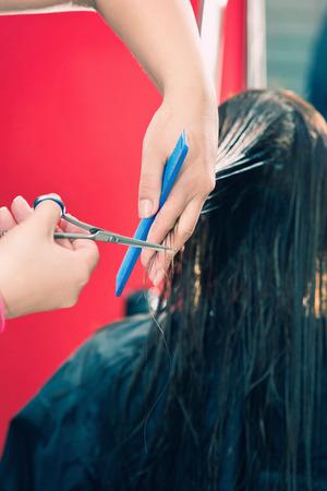 haircutting: Cutting long brown hair in hair salon