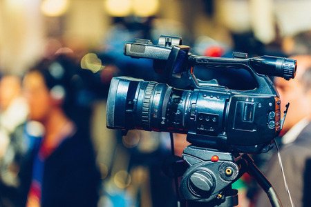 commercial event: TV camera recording press conference Stock Photo