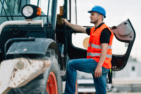 skid loader: Manual Worker on Skid Steer Loader