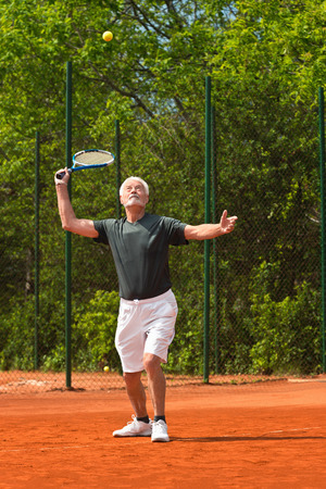 70s tennis: Active senior playing tennis