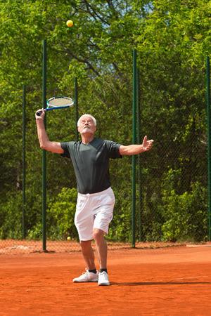 70s tennis: Active senior playing tennis
