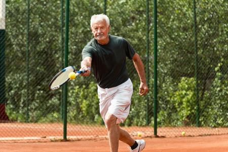 70s tennis: Senior man exercising tennis