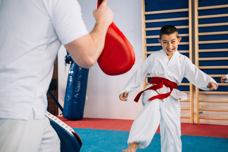 Tae kwon do instructor with little boy on class Stock Photo