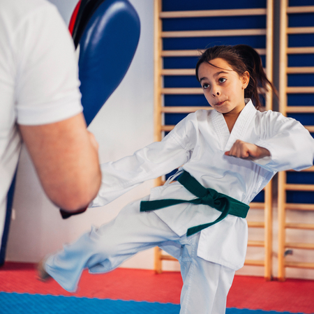 Girl on Tae kwon do training with trainer Stock Photo