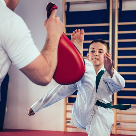 Tae kwon do instructor with kids on class