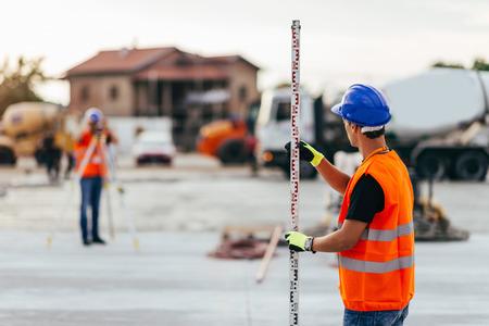 Surveyors on construction site