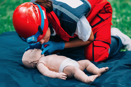 Cpr training on baby dummy outdoors Stock Photo
