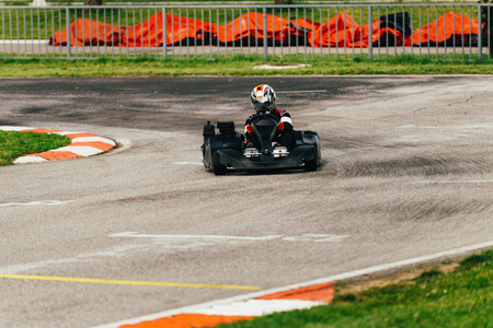 champ: Woman driving go-cart on a sports track