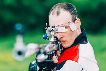 Man on free rifle triaing outdoors Stock Photo