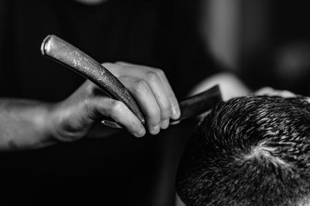 Hair styling man in hairsalon by hairdresser