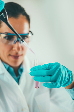 geneticist: Laboratory technician using micro pipette Stock Photo