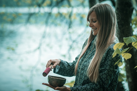 Young woman with Tibetan bowl