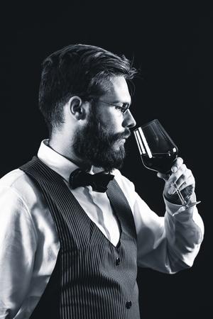 Sommelier tasting red wine Stock Photo