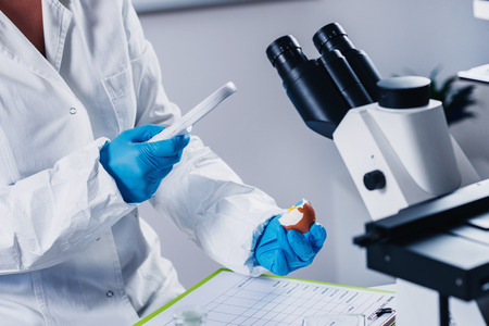 specimen testing: Quality control expert inspecting at egg in the laboratory Stock Photo