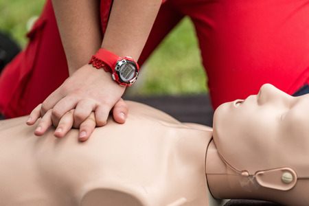 Cpr training outdoors. Reanimation procedure on CPR doll