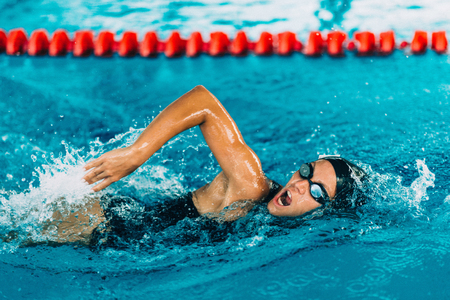 Professional swimmer, swimming race, indoor pool Stock Photo