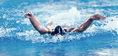 Professional swimmer, swimming race, indoor pool Stok Fotoğraf