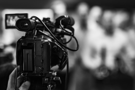 Camera at media conference Stock Photo