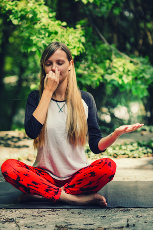 Pranayama. Alternate nostril breathing exercise in yoga