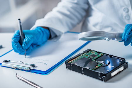 Forensic science expert examining hard drive