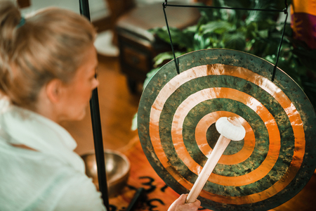Therapist using Gong in sound therapy