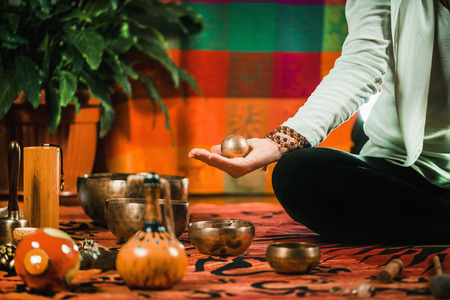Therapist using Meditation Ball in sound therapy