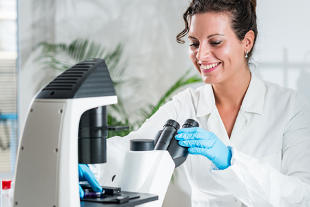 Quality control expert inspecting at meat  in the laboratory Stock Photo
