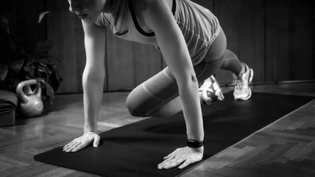 Woman doing High-intensity interval training at home Stock fotó