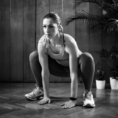Woman Doing Sumo Squats on High-intensity interval training at home. Archivio Fotografico