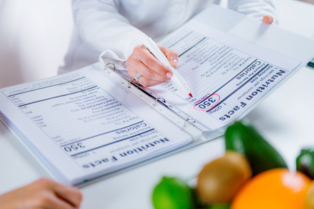 Doctor nutritionist, dietician and female patient on consultation in the office Zdjęcie Seryjne