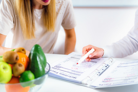 Doctor nutritionist, dietician and female patient on consultation in the office Banque d'images