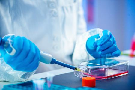 Biotechnology. Female scientist working in laboratory