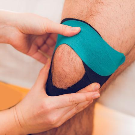 Knee treatment with kinesio tape