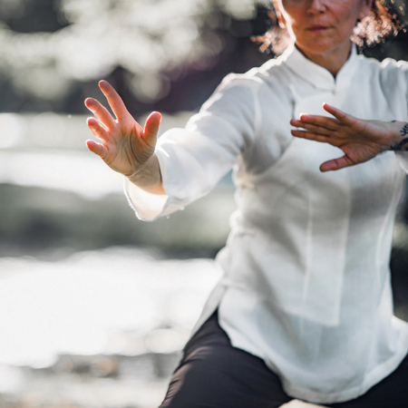 Woman practicing Tai Chi Quan in the park Stock Photo