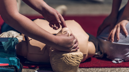 First Aid Training Outdoors. Cardiopulmonary resuscitation. First aid course. Reklamní fotografie - 110705671