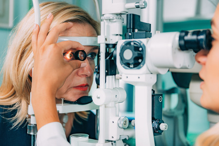 Ophthalmology. Examination With Magnifying Glass